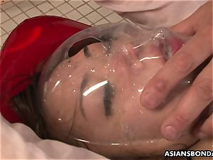 chinese babe gets soaked in pee while being pummeled