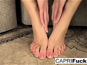 Capri plays with her muff and soles