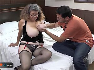 AgedLove plump mature is plumbing on bed