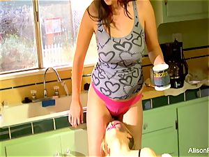 Alison Tyler and Katie Summers pound in the kitchen