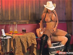 Bridgette B in torrid leather footwear and smashes on a bed